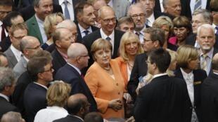 A chanceler alemã Angela Merkel, durante o voto no Parlamento alemão da ajuda aos bancos espanhóis na quinta-feira (19).