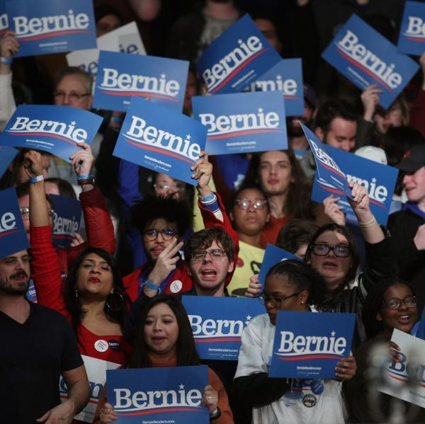 Supporters wave Bernie Sander's placards at a US Rally
