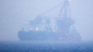 The Russian pipe-laying ship Fortuna, which has been hit by US sanctions, is seen in the fog anchored in the Baltic Sea off the port of Rostock in Germany in January 2021 during work on the controversial Nord Stream 2 gas pipeline