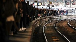 Commuters clog a platform at Gare Saint-Lazare train station in Paris as a strike continues against French government pension reform plans, 9 December 2019.