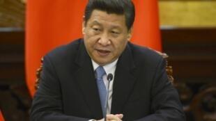 O presidente chinês, Xi Jinping, comanda o país que mais elevou o arsenal nuclear em 2012.