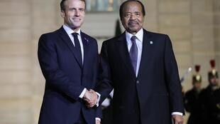 French President Emmanuel Macron greets Cameroon President Paul Biya at the Elysee Palace in Paris on 11 November 2019.