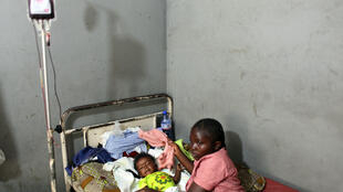 Deborah Mangili and her daughter Kunda in hospital.