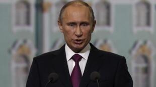 Tổng thống Nga Vladimir Putin phát biểu tại Diễn đàn Kinh tế Saint Petersbourg ngày 21/06/2013.