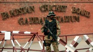 A Pakistani soldier stands guard outside the Gaddafi Cricket Stadium ahead of a Twenty20 international cricket match between Pakistan and Sri Lanka in Lahore.