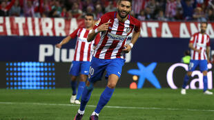 Yannick Ferreira-Carrasco scored the first hat-trick of his career in Atletico Madrid's 7-1 destruction of Granada.