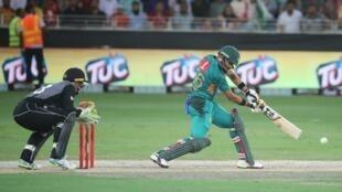 Babar Azam plays a shot during the Pakistan-New Zealand T20 match in Dubai.