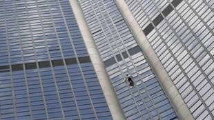 "French climber Alain Robert, also known as ""Spiderman"", scales the Tour Montparnasse for Nepal on Tuesday"