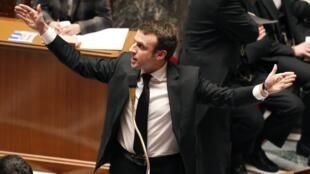 Министр экономики Франции Эмманюэль Макрон в Национальной ассамблее, Париж, 17 февраля 2014 г.