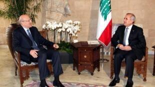 President Michel Sleiman (R) with Najib Mikati in January