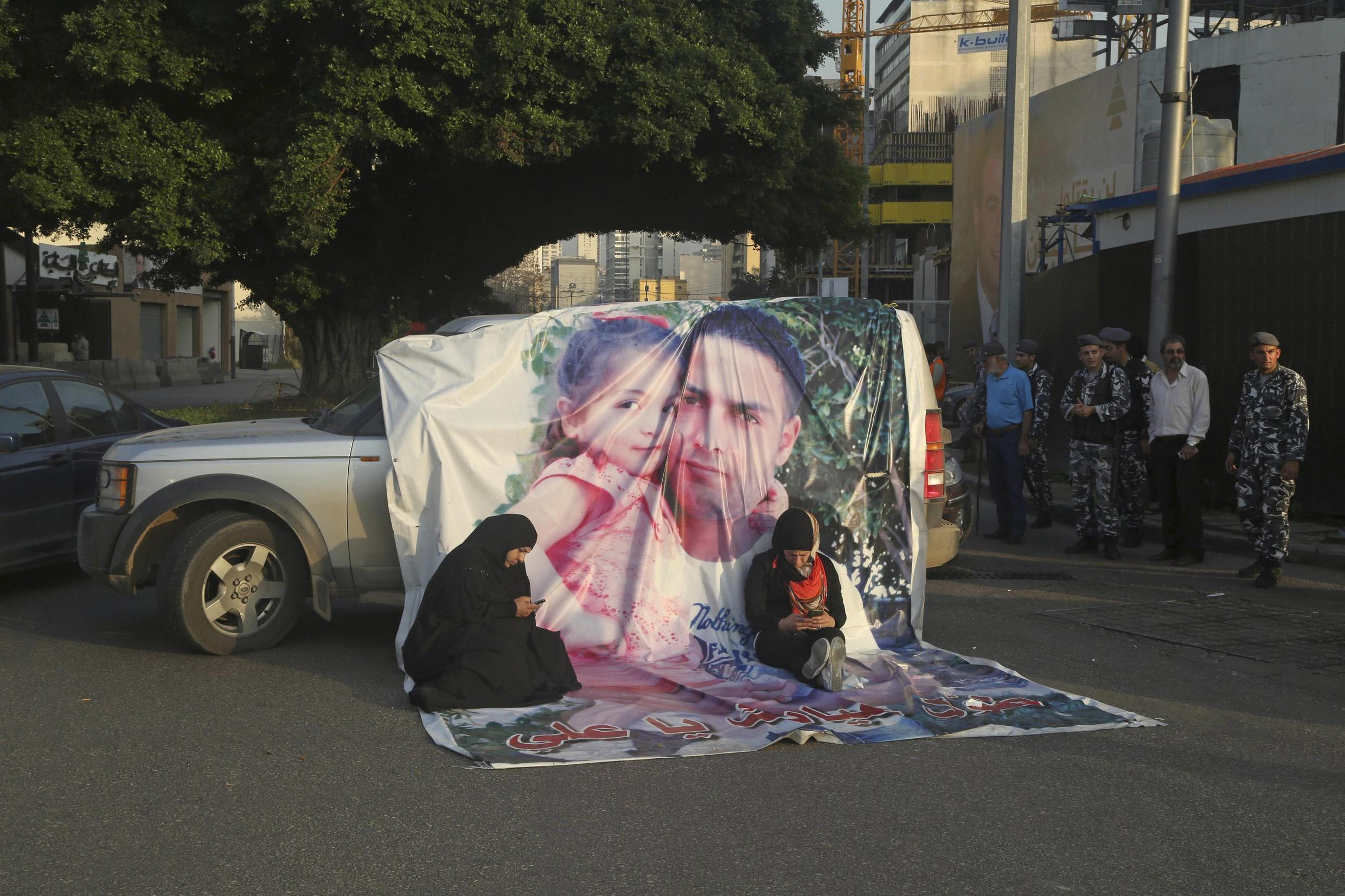 A portrait of police officer Ali Bazzal executed by the Al-Nusra Front on show in a Beirut street