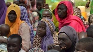 Wasu fararen hula da Boko Haram ta yi garkuwa da su bayan samun nasarar ceto su da sojin Najeriya suka yi