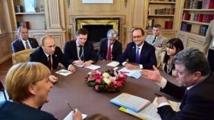 De izq. a der: Angela Merkel, Vladimir Putín, François Hollande y Petro Porochenko, los líderes de Alemania, Rusia, Francia y Ucrania en un encuentro en octubre pasado en Milán.