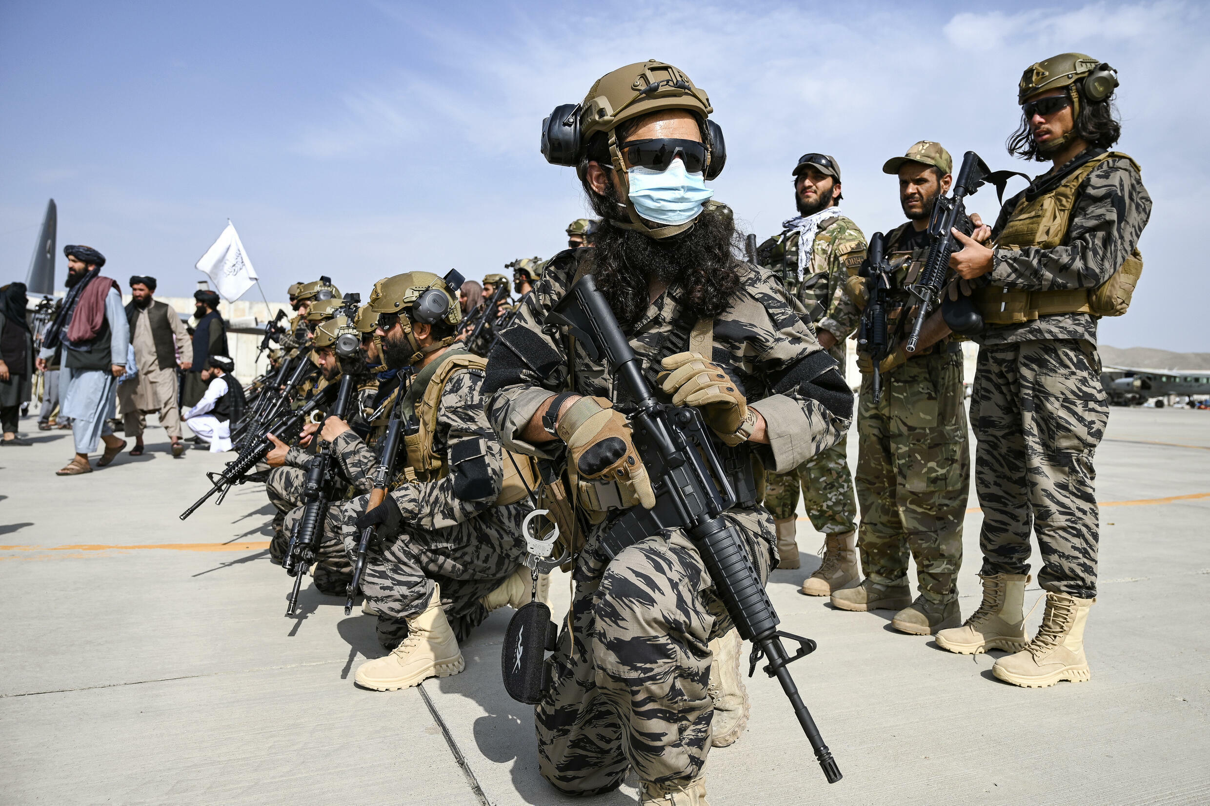 Members of the Taliban Badri 313 military unit take up positions at the airport in the Afghan capital Kabul after the US pulled its last troops out of the country