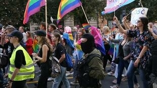 Police officer is seen as participants attend the Equality March in support of the LGBT community in Szczecin, Poland September 14, 2019.