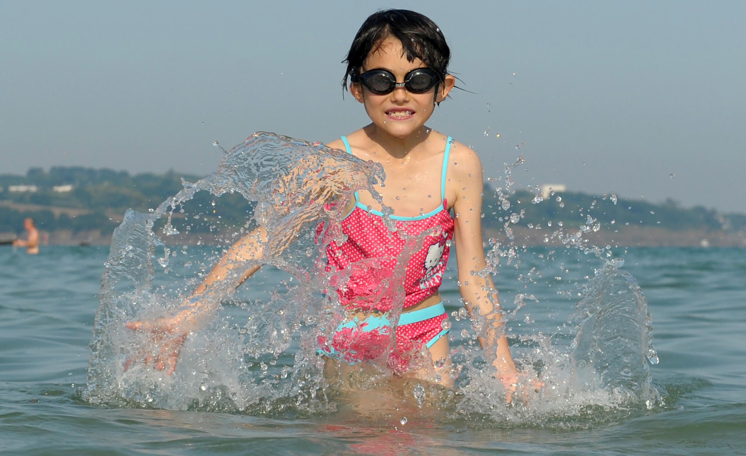 A child plays in the water on a beach in Fouesnant, western France.