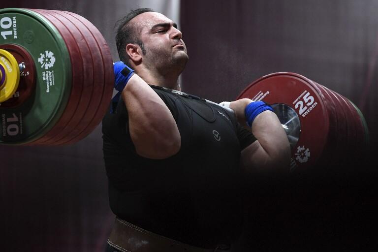 Iran's Behdad Salimikordasiabi attempts a lift during the Asian Games in Jakarta.