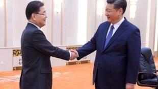 中國國家主席習近平3月12日在人民大會堂會見韓國總統特使鄭義溶