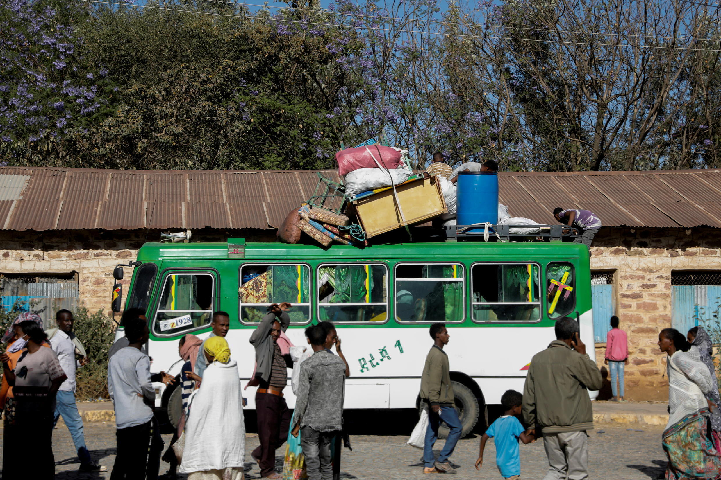 A bus carrying displaced people arrives at the Tsehaye primary school, which was turned into a temporary shelter for people displaced by conflict, in the town of Shire, Tigray region, Ethiopia, March 14, 2021.