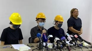 Three masked young people from Hong Kong's recent ongoing anti-government movement hold a press conference in Hong Kong on August 6, 2019.