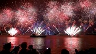 Fireworks explode over Victoria Harbour and Hong Kong Convention and Exhibition Centre during a pyrotechnic show to celebrate the New Year in Hong Kong, China January 1, 2018.