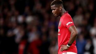 Dan wasan tsakiya na Manchester United Paul Pogba