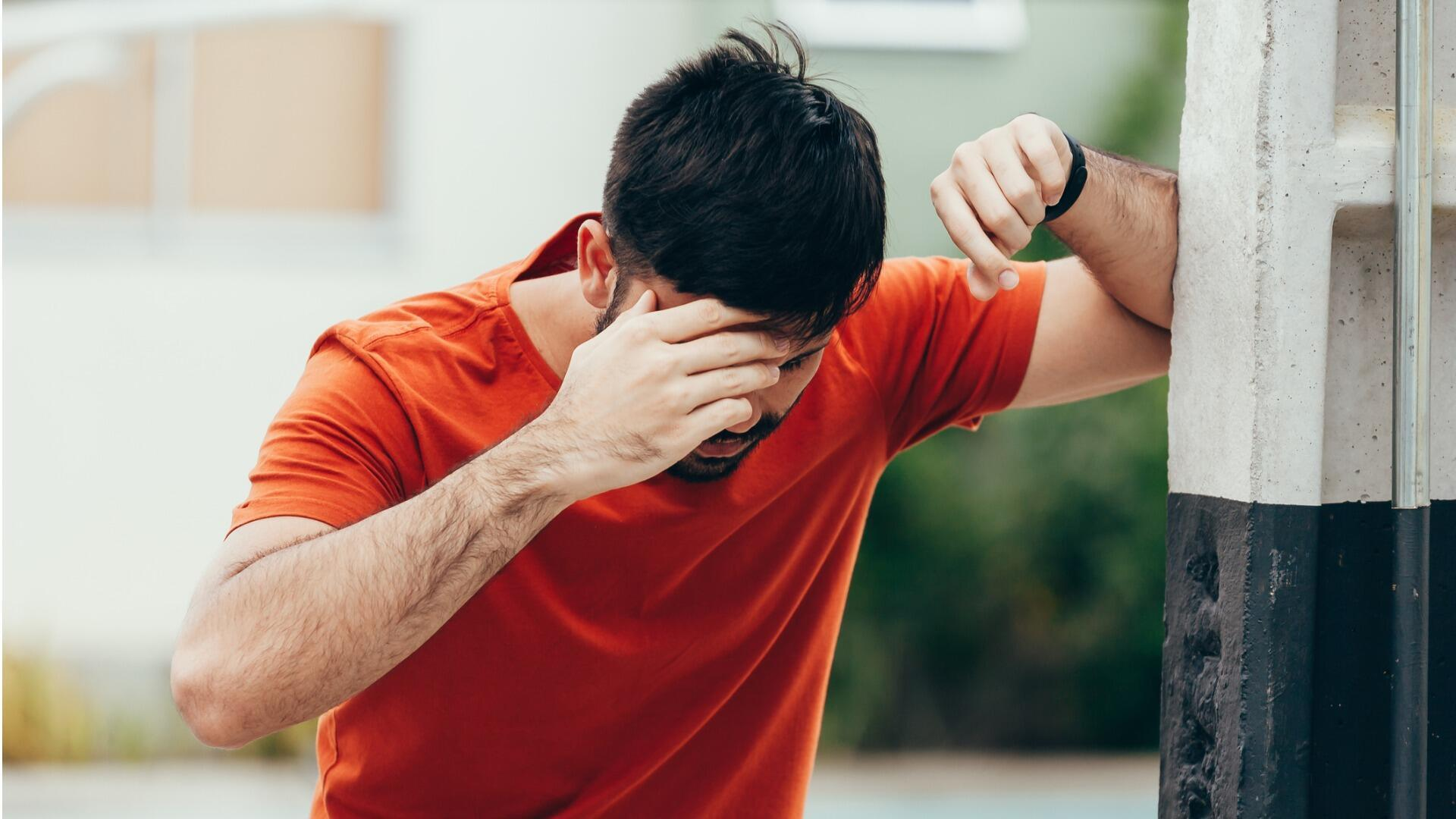 man-suffering-from-dizziness-with-difficulty-standing-up-while-on-picture-id1019539142