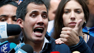 Venezuelan opposition leader and self-proclaimed interim president Juan Guaido accompanied by his wife Fabiana Rosales, speaks to the media after a holy mass in Caracas, Venezuela, January 27, 2019.