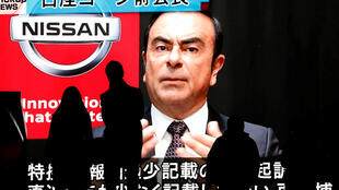 A monitor broadcasts news of ousted Nissan Motor chairman Carlos Ghosn in Tokyo