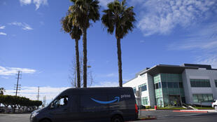 An Amazon. delivery driver departs a distribution facility in Hawthorne, California. The e-commerce giant said it was installing cameras which use artificial intelligence to monitor driver safety