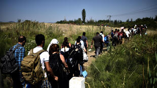 In September 2015, AFP first meets a young Iraqi couple among the wave of migrants on the Balkan Route, seeking a new, safer life in Europe