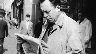 French writer and 1957 literature Nobel prize laureate Albert Camus, reading a newspaper in Paris in 1953.