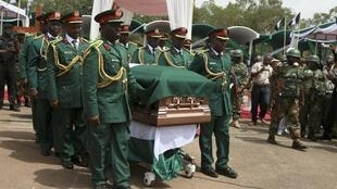 Soldiers carry the casket of Biafran ex-warlord Lieutenant Colonel Odumegwu Ojukwu during a national funeral ceremony in Nigeria