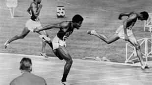 Gold medal winner: Lee Evans (centre) crosses the finish line of the Men's 400m final at the 1968 Mexico Olympics