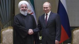 Tổng thống Nga Vladimir Putin (P) và đồng nhiệm Iran Hassan Rouhani tại Ankara, Thổ Nhĩ Kỳ, ngày 04/04/2018.