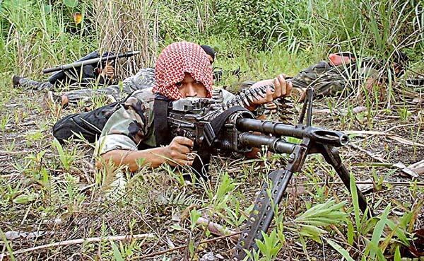 Ảnh minh họa. Một chiến binh thuộc phong trào Hồi Giáo nổi dậy Mặt trận Giải Phóng Hồi Giáo Moro.