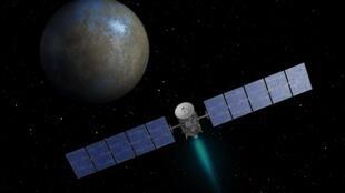 Vue d'artiste de la sonde Dawn de la Nasa approchant Cérès.