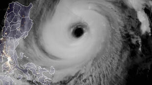 A satellite image shows Typhoon Surigae off the eastern coast of the Philippines on Tuesday