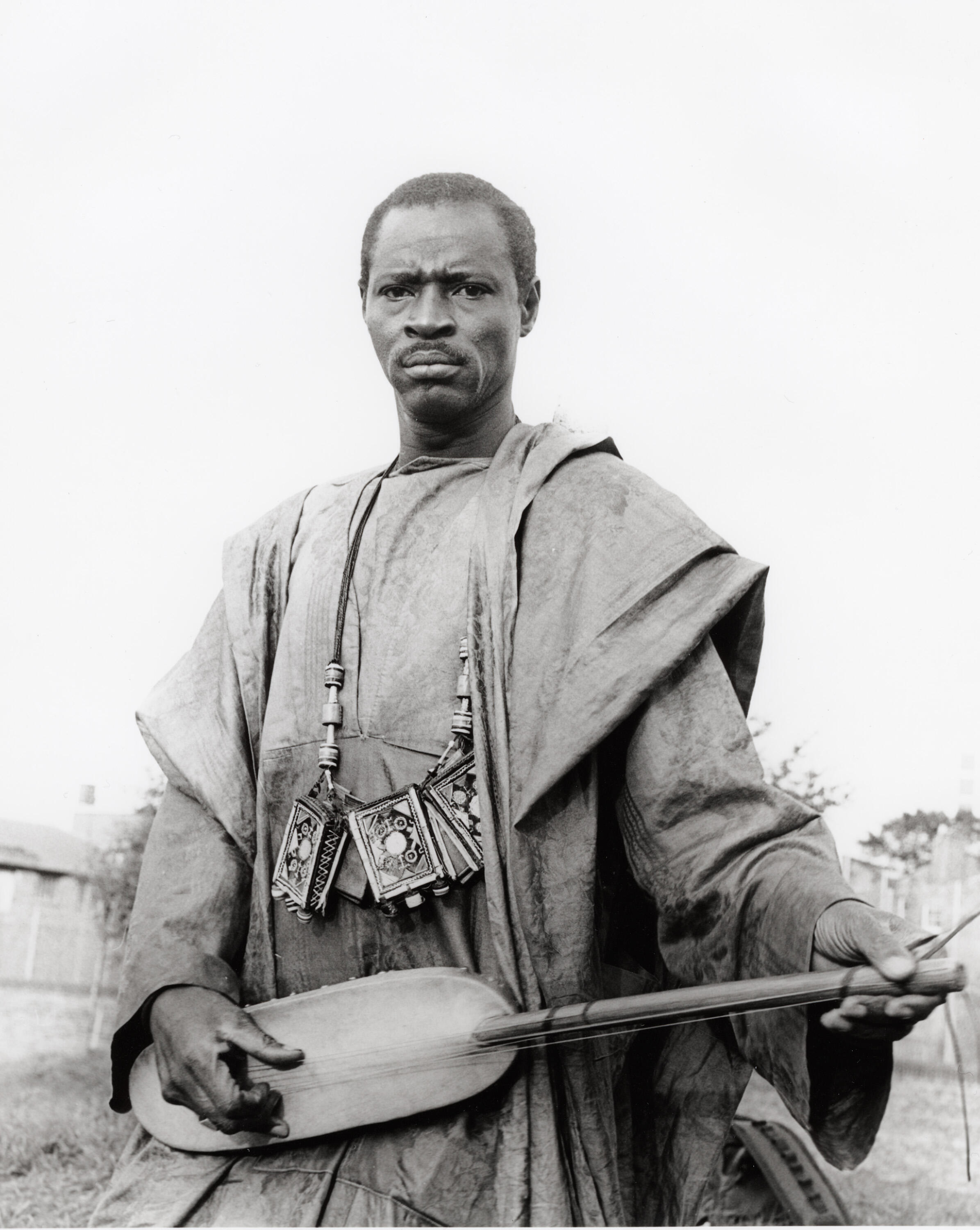 Ali Farka Touré with the ngoni. Born near Timbuktu in the north of Mali, the master bluesman knew the value of his country's music.