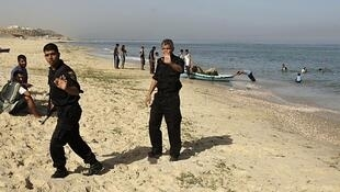 Hamas security forces on a beach in central Gaza, 7 June.