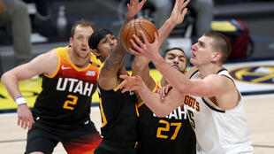 Denver's Nikola Jokic drives to the basket against Utah's Joe Ingles, Jordan Clarkson and Rudy Gobert in the Nuggets' 128-117 NBA victory over the Jazz