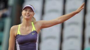 Maria Sharapova celebrates defeating Hsieh Su-Wei