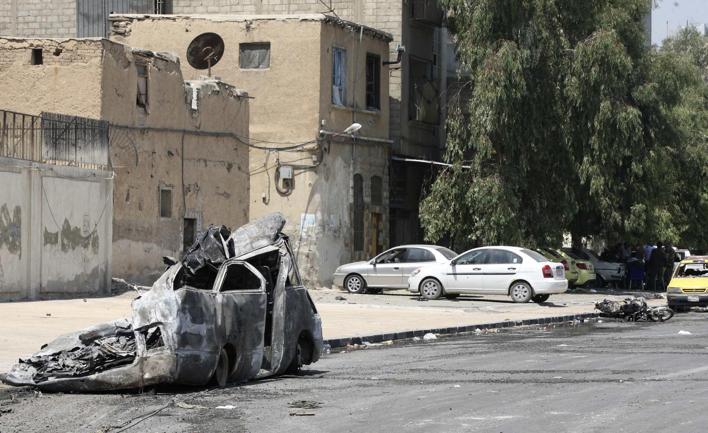 Imagens de destruição são registradas na capital Damasco, nesta sexta-feira.