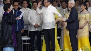 Aquino takes the oath office in front of Supreme Court Justice Conchita Carpio Morales
