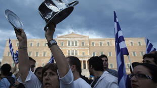 Indignant protesters in front of the Greek parliament
