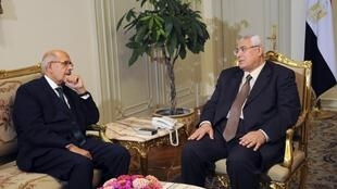 Le président par intérim Adly Mansour (à droite) et Mohamed el-Baradei, au Caire, le 6 juillet 2013.