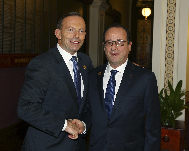 នាយករដ្ឋមន្ត្រីអូស្ត្រាលី លោក Tony Abbott  និងប្រធានាធិបីតីបារាំងលោក  François Hollande