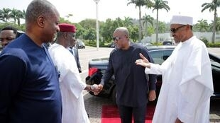 President Buhari greets Mahama in Abuja on 9 January ahead of a meeting about the situation in Gambia.