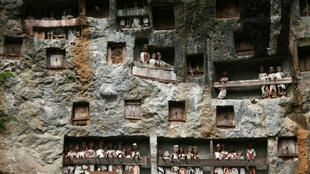 On the Indonesian island of Sulawesi, the animist Toraja people bury their dead in the cliffs and continue interacting with them via life-sized wooden effigies