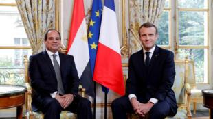 图为法国总统马克龙2017年10月24日与到访埃及总统西西在爱丽舍宫会谈